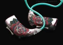 two hearing aids witrh colourful pictures of roses on them.