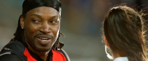 HOBART, AUSTRALIA - JANUARY 04:  Chris Gayle of the Melbourne Renegades gives a TV interview to Mel Mclaughlin during the Big Bash League match between the Hobart Hurricanes and the Melbourne Renegades at Blundstone Arena on January 4, 2016 in Hobart, Australia.  (Photo by Darrian Traynor/Getty Images)